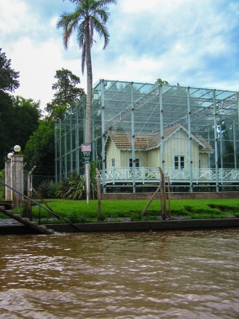 Glass enclosed house on the bank of the river